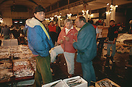 "April 27, 1990, Rome, Italy. Photographing for the book ""One day in the life of Italy"", this is an exploration of Rome. Around 4am to 5am, at Lungotevere,  a very busy meat, fish and vegetable market is shown."