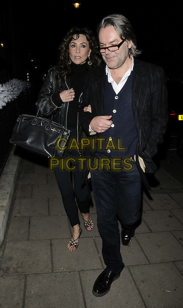 LONDON, ENGLAND - DECEMBER 09: Marie Helvin &amp; guest depart after an evening meal at 34 restaurant, 34 restaurant, South Audley St.., on December 09, 2013 in London, England, UK.<br /> CAP/CAN<br /> &copy;Can Nguyen/Capital Pictures