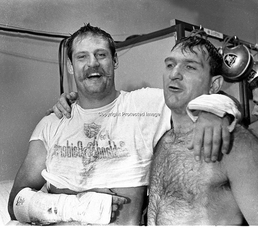 Oakland Raider lineman after tougjh game, Ben Davidson and teammate Dan Birdwell in locker room.<br />