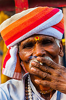 Indian man smoking a bidi (Clove cigarette), Holi (festival of colors), Mathura, Uttar Pradesh, India.