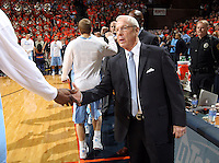 North Carolina head coach Roy Williams greets his players during an NCAA basketball game against Virginia Monday Jan. 20, 2014 in Charlottesville, VA. Virginia defeated North Carolina 76-61.