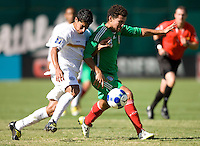 05 July 2009:  Edgar Duenas of Mexico controls the ball away from Felix Zeledon of Nicaragua at Oakland-Alameda County Coliseum in Oakland, California.    Mexico defeated Nicaragua, 2-0.