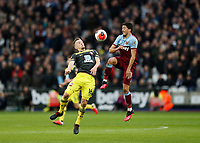29th February 2020; London Stadium, London, England; English Premier League Football, West Ham United versus Southampton; James Ward-Prowse of Southampton and Pablo Fornals of West Ham United compete for the loose ball
