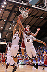SIOUX FALLS, SD - MARCH 9:  Brandon Bos #12 of the University of South Dakota gets a layup over Western Illinois defenders Don McAvoy III #34 and Jordna Foster #10 during their men's quarter-final game at the 2013 Summit League Basketball Championships Saturday at the Sioux Falls Arena.  (Photo by Dick Carlson/Inertia)
