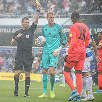 Huddersfield Town's Adama Diakhaby is shown a yellow card by Referee Dean Whitestone<br /> <br /> Luke Brennan/CameraSport<br /> <br /> The EFL Sky Bet Championship - Queens Park Rangers v Huddersfield Town - Saturday 10th August 2019 - Loftus Road - London<br /> <br /> World Copyright © 2019 CameraSport. All rights reserved. 43 Linden Ave. Countesthorpe. Leicester. England. LE8 5PG - Tel: +44 (0) 116 277 4147 - admin@camerasport.com - www.camerasport.com