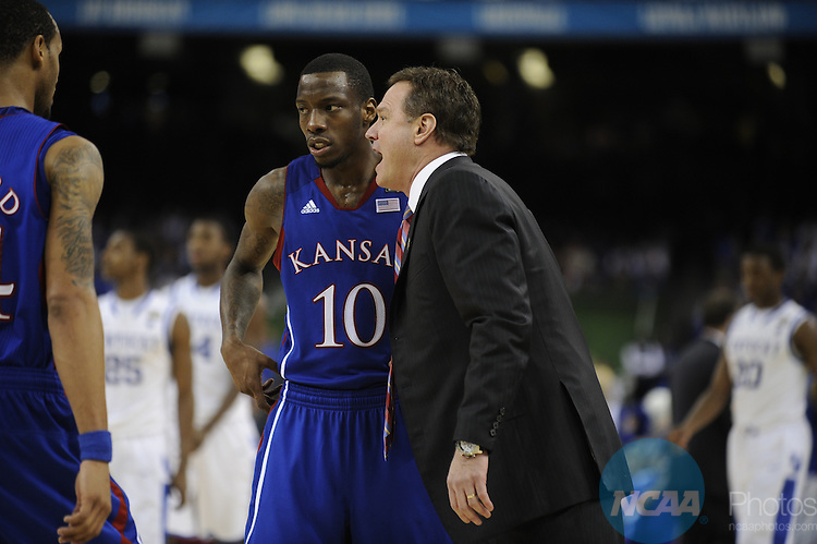 02 APR 2012: Head coach Bill Self from the University of Kansas gives instructions to guard Tyshawn Taylor (10) during the Championship Game of the 2012 NCAA Men's Division I Basketball Championship Final Four held at the Mercedes-Benz Superdome hosted by Tulane University in New Orleans, LA. Kentucky defeated Kansas 67-59 to claim the championship title. Ryan McKee/ NCAA Photos.