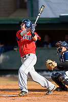 Kevin Scholly #3 of the Shippensburg Red Raiders follows through on his swing versus the Catawba Indians on February 14, 2010 in Salisbury, North Carolina.  Photo by Brian Westerholt / Four Seam Images