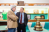 Mississippi Gov. Phil Bryant, left, visits with Mississippi State Football Head Coach Dan Mullen near the Egg Bowl trophy during a Wednesday evening [Feb. 15] legislative event at Brent&rsquo;s Drugs in Jackson.<br />  (photo by Beth Wynn / &copy; Mississippi State University)