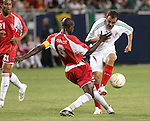 21 June 2007:  Guadeloupe's Alain Vertot (6) plays the ball away from Mexico's Cuauhtemoc Blanco (10). The National Team of Mexico defeated Guadeloupe 1-0  in a CONCACAF Gold Cup Semifinal match at Soldier Field in Chicago, Illinois.