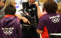 18.07.2012. London, England.  An armed police officer stands guard as security measures have been stepped-up at Heathrow airport in London, Britain, 18 July 2012. The London 2012 Olympic Games will start on 27 July 2012.