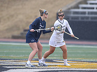 Towson, MD - February 10, 2018: Towson Natalie Sulmonte (11) and Penn State Madison Carter (24) at the faceoff during game between Towson and Penn St at  Minnegan Field at Johnny Unitas Stadium  in Towson, MD.   (Photo by Elliott Brown/Media Images International)