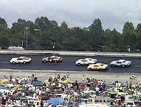 David Pearson, Donnie Allison, Buddy Baker, Cecil Gordon, Lennie Pond race action infield crowd Southern 500 Darlington Raceway, Darlington SC, September 5, 1977.(Photo by Brian Cleary/www.bcpix.com)