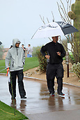 February 3rd 2019, Scottsdale, Arizona, USA;  Volunteers walk through the venue in the rain before the final round of the Waste Management Phoenix Open on February 3, 2019, at TPC Scottsdale in Scottsdale, Arizona.