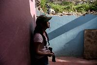 BOGOTA - COLOMBIA, 27-05-2020: Danna (15), joven con síndrome de Dawn quien fue desalojada junto con su madre. Mas de 200 familias terminan el proceso de desalojo en el predio La Estancia al sur de Bogotá quedando sin ninguna ayuda ni un techo donde vivir durante la cuarentena total en el territorio colombiano causada por la pandemia  del Coronavirus, COVID-19. / Danna (15), a young man with Dawn syndrome who was evicted along with her mother. More than 200 families are evicted from La Estancia farm at south of Bogota city and they left withoput any help and shelter to live during total quarantine in Colombian territory caused by the Coronavirus pandemic, COVID-19. Photo: VizzorImage / Mariano Vimos / Cont