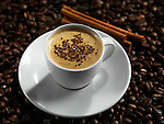 Cup of coffe latte with chocolate on coffee beans background