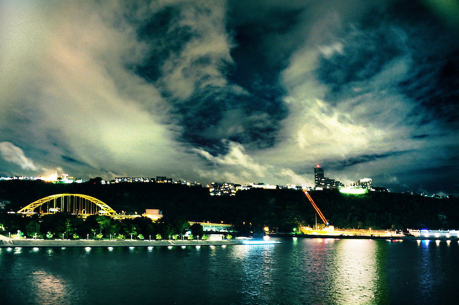 A powerful storm front blows into Pittsburgh, PA just minutes after September 11, 2016 began. The site to the left, dotted with equally spaced trees and lights is Point State Park where George Washington founded Fort Pitt. Mt. Washington is in the background along the Ohio River where the glaciers had ended their advance.