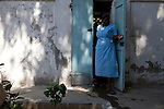 A staff member exits the St. Francois De Sales hospital in Port-au-Prince, Haiti. The hospital's main building collapsed in the recent earthquake, forcing patients to be treated outside in the courtyard.