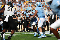 CHAPEL HILL, NC - SEPTEMBER 21: Sam Howell #7 of the University of North Carolina hands the ball off to Michael Carter #8 during a game between Appalachian State University and University of North Carolina at Kenan Memorial Stadium on September 21, 2019 in Chapel Hill, North Carolina.
