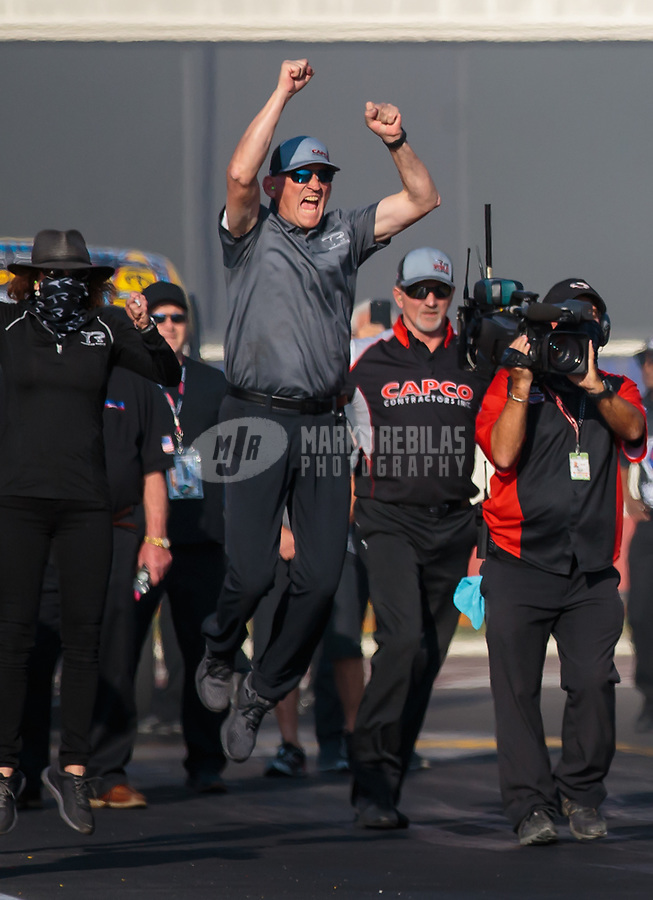 Nov 11, 2018; Pomona, CA, USA; Crew members for NHRA top fuel driver Steve Torrence celebrate during the Auto Club Finals at Auto Club Raceway. Mandatory Credit: Mark J. Rebilas-USA TODAY Sports