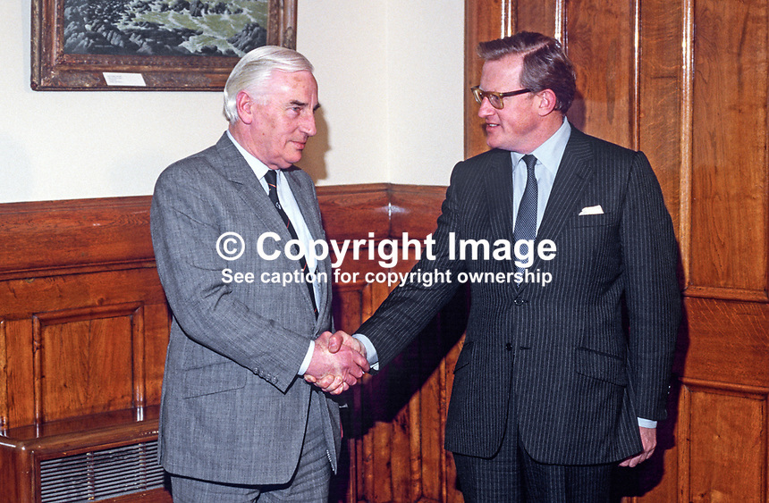 Peter Barry, Minister for Foreign Affairs, Rep of Ireland, left, is welcomed to the first session of the Anglo-Irish Agreement at Stormont Castle, Belfast, by Tom King, UK Secretary of State for N Ireland. 19851201PB3.<br />