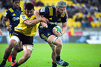 Highlanders' Pari Pari Parkinson tries to get away from Hurricanes' Isaia Walker-Leawere during the Super Rugby match between the Hurricanes and Highlanders at Westpac Stadium in Wellington, New Zealand on Friday, 1 March 2019. Photo: Dave Lintott / lintottphoto.co.nz