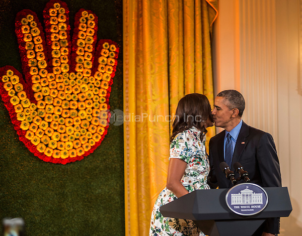 WASHINGTON, DC - JULY 10: First Lady Michelle Obama welcome 55 winners and their families to the White House during the 5th Annual Kid's State Dinner on July 10, 2015. Credit: Patsy Lynch/ MediaPunch