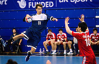 06 APR 2012 - LONDON, GBR - Argentina's Guido Riccobelli (ARG) (left, in blue and white) prepares to shoot during the men's 2012 London Cup match against South Korea at the National Sports Centre in Crystal Palace, Great Britain (PHOTO (C) 2012 NIGEL FARROW)