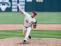 NWA Democrat-Gazette/CHARLIE KAIJO Arkansas Razorbacks Kevin Kopps (45) throws a pitch during game two of the College Baseball Super Regional, Sunday, June 9, 2019 at Baum-Walker Stadium in Fayetteville. Ole Miss forces a game three with a 13-5 win over the Razorbacks