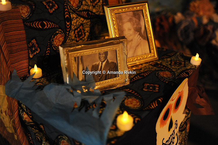 Photographs of former Chicago mayors Harold Washington and Jane Byrne on a mobile ofrenda or offering during community arts organization ElevArte's Dia de los Muertos celebration in Dvorak Park in the Pilsen neighborhood in Chicago, Illinois on November 2, 2015.  Dia de los Muertos is the Mexican celebration of the Catholic holiday known as All Souls Day, which comes after All Saints Day and honors the dead.