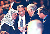 The Speaker of the United States House of Representatives J. Dennis Hastert (Republican of Illinois) is greeted by Chairman Yasser Arafat, left, of the Palestinian Authority as they meet informally at the National Prayer Breakfast at the Washington Hilton Hotel in Washington, DC on February 4, 1999.  From left to right: Chairman Arafat, US State Department Arabic interpreter Gamal Helal, Speaker Hastert and US Senator Pete Domenici (Republican of New Mexico).  <br /> Credit: Ron Sachs / Pool via CNP