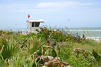 Life Guard Station located at Lake Worth Beach, Lake Worth, Florida. Note the two Paragliders in the air to the left and right of the station.