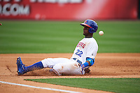 Buffalo Bisons center fielder Junior Lake (22) slides into third during a game against the Louisville Bats on June 23, 2016 at Coca-Cola Field in Buffalo, New York.  Buffalo defeated Louisville 9-6.  (Mike Janes/Four Seam Images)