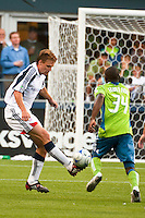 Edgaras Jankauskas (l) of the New England Revolution works the ball against Jhon Kennedy Hurtado (34) of the Seattle Sounders in the match at the XBox Pitch at Quest Field on August 20, 2009. The Revolution defeated the Sounders 1-0.