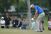 Padraig Harrington (IRL) takes his putt on the 3rd green during Friday's resumed Round 2 of the 2011 Barclays Singapore Open, Singapore, 11th November 2011 (Photo Eoin Clarke/www.golffile.ie)