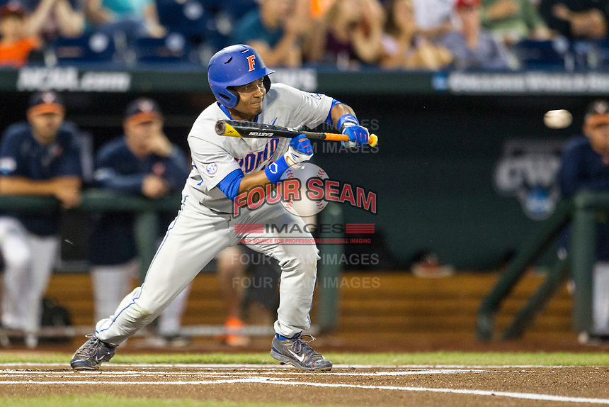 Florida Gators shortstop Richie Martin (12) squares to bunt during the NCAA College baseball World Series against the Virginia Cavaliers on June 15, 2015 at TD Ameritrade Park in Omaha, Nebraska. Virginia defeated Florida 1-0. (Andrew Woolley/Four Seam Images)