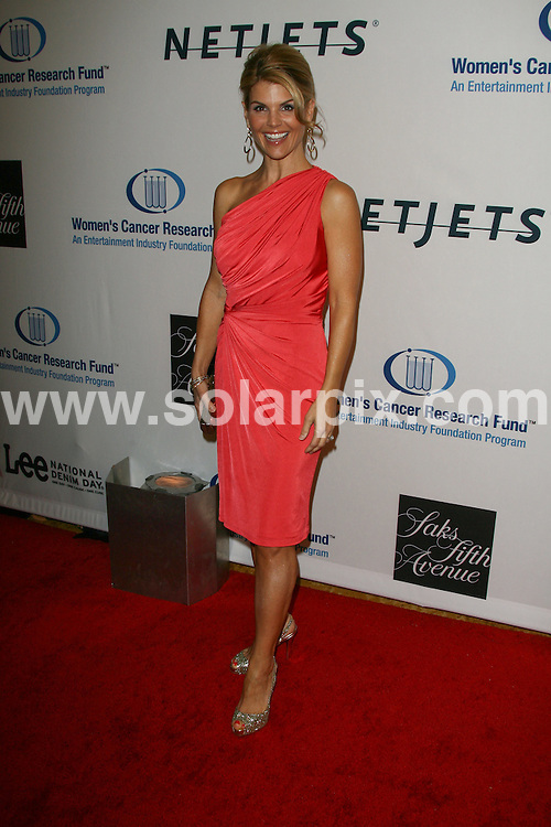 **ALL ROUND PICTURES FROM SOLARPIX.COM**.**SYNDICATION RIGHTS FOR UK, AUSTRALIA, DENMARK, PORTUGAL, S. AFRICA, SPAIN & DUBAI (U.A.E) ONLY**.13th Annual Unforgettable Evening Benefiting the Entertainment Industry Foundation's Women's Cancer Research Fund - Arrivals, at the Beverly Wilshire Hotel, Beverly Hills, CA, USA. 27 January 2010.This pic: Lori Loughlin..JOB REF: 10564 PHZ Charlotte   DATE: 27_01_2010.**MUST CREDIT SOLARPIX.COM OR DOUBLE FEE WILL BE CHARGED**.**MUST NOTIFY SOLARPIX OF ONLINE USAGE**.**CALL US ON: +34 952 811 768 or LOW RATE FROM UK 0844 617 7637**