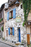A cobble stone street in the old town with charming character-full old stone houses, sign saying Le Colombier de Grando and Roxane Bed and Breakfast on Place de la Myrpe, facing Place du Docteur Cayla Square Bergerac Dordogne France
