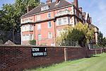Scoreboard on playing field wall near boarding house of Eton College, Berkshire, England