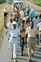 James Meredith March Through Mississippi, June 1966. Marchers along the route. Front row left - CORE leader, Floyd McKissick. Civil Rights. Black. Protest. African American. Personalities. Floyd McKissick, Chairman of CORE