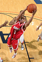 Dec. 07, 2010; Charlottesville, VA, USA;  Radford Highlanders guard Jeremy Robinson (1) shoots in front of Virginia Cavaliers forward Mike Scott (23) during the game at the John Paul Jones Arena. Virginia won 54-44. Mandatory Credit: Andrew Shurtleff