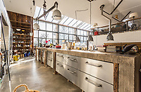 BNPS.co.uk (01202 558833)<br /> Pic: Strutt&Parker/BNPS<br /> <br /> House of Fun - Hapsford Stables is a wacky conversion into an unusual family home.<br /> <br /> A fun family home that comes with a slide and a fireman's pole is on the market for £3.295m.<br /> <br /> The new owners of Hapsford Stables near Frome, Somerset, will never have to walk down the stairs again with the two novel ways of getting to the ground floor in this property.<br /> <br /> The owner bought the property as a stable yard and groom's cottage and transformed it into a quirky and stylish contemporary house.<br /> <br /> It also comes with stables, a swimming pool and 28 acres of land.<br /> <br /> The slide offers an amusing alternative to the stairs leading from the library to the kitchen and family room, while the fireman's pole is under a hatch in the guest bedroom suite and leads directly into the stables below - in case anyone needs a quick getaway on a horse.