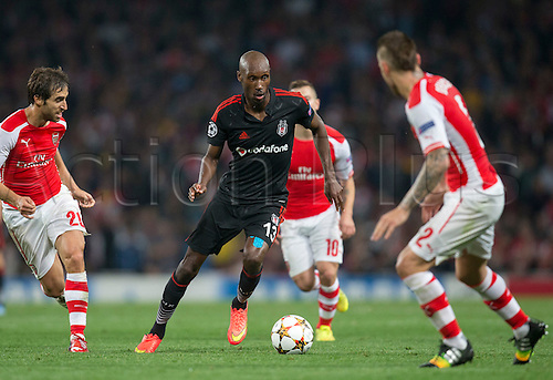 27.08.2014.  London, England. Champions League Qualifying 2nd Leg. Arsenal versus Besiktas. Besiktas Atiba Hutchinson looks to go between the Arsenal defenders.
