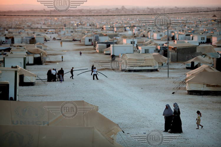 Night falls at Zaatari Refugee Camp. Approximately two million people have fled the conflict in Syria. At least 130,000 of them live in Zaatari Refugee Camp, although it was designed to house 60,000, and a further 2,000 people arrive each day.