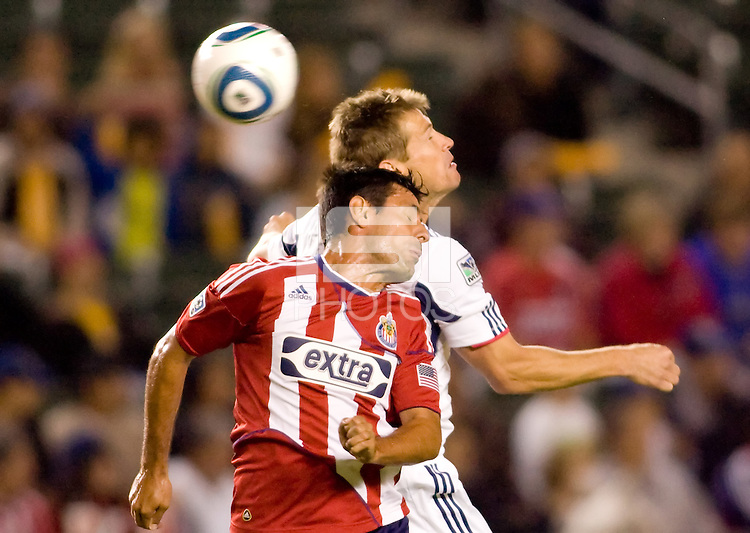 Ante Jazic Chivas USA defender goes head to head with Brian McBride Captain and forward of the Chicago Fire during McBrides last game of his career. The Chicago Fire defeated CD Chivas USA 3-1 at Home Depot Center stadium in Carson, California on Saturday October 23, 2010.