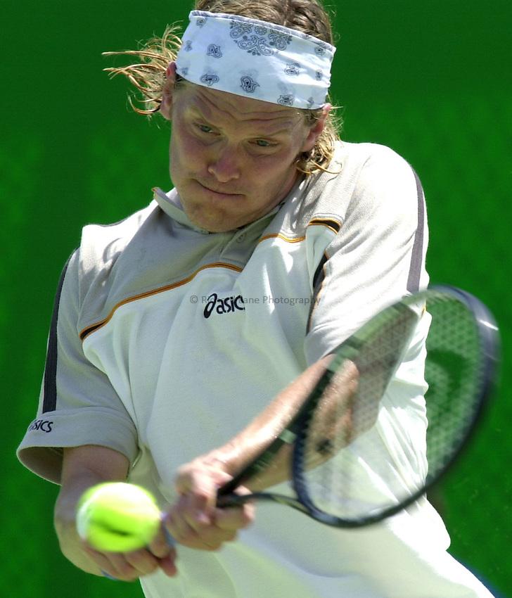 Australian Open Tennis 2003.13/01/2003.Thomas Enqvist of Sweden in first round match against Gaston Gaudio of Argentina.