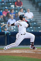 Mac Williamson (7) of the Richmond Flying Squirrels follows through on his swing against the Bowie Baysox at The Diamond on May 23, 2015 in Richmond, Virginia.  The Baysox defeated the Flying Squirrels 3-2.  (Brian Westerholt/Four Seam Images)