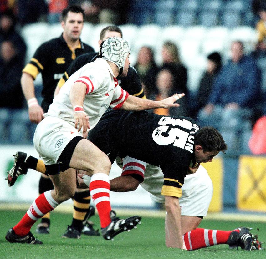 Photo. Richard Lane.Wasps v Ulster. 9/1/2000.Jon Ufton comes crashing down.