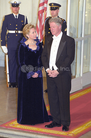 United States President Bill Clinton, left, and first lady Hillary Rodham Clinton, stand on the North Portico of the White House in Washington, D.C. awaiting the arrival of King Juan Carlos I and Queen Sofia of Spain for a State Dinner on February 23, 2000.<br /> Credit: Ron Sachs / CNP/MediaPunch