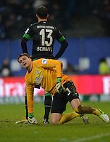 FUSSBALL   1. BUNDESLIGA   SAISON 2012/2013    19. SPIELTAG Hamburger SV - SV Werder Bremen                          27.01.2013 Sebastian Mielitz (vorn) und Lukas Schmitz (beide, SV Werder Bremen) sind nach dem 3:1 enttaeuscht