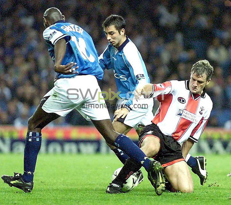 PIX: Ben Duffy....Man City v Southhampton..15/9/99...COPYWRIGHT PICTURE>> SIMON WILKINSON>>01943 436649>>..Saints Mark Hughes beats Goater in the tackle
